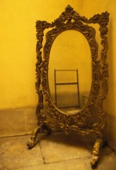 Ornate Mirror in the Corner of a Room
